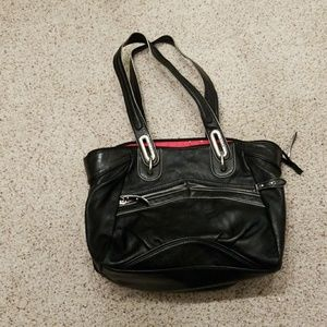 Black Elle purse with red polka dot lining