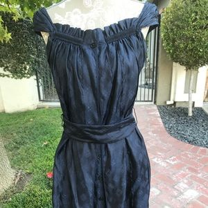 Navy blue sleeveless summer dress.