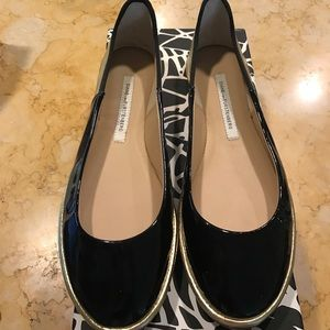 DVF black and gold flats