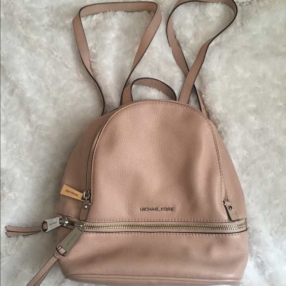 cb3c4ecb03c2 Light pink Michael Kors mini backpack purse. M_59cd468b9c6fcfe866001514