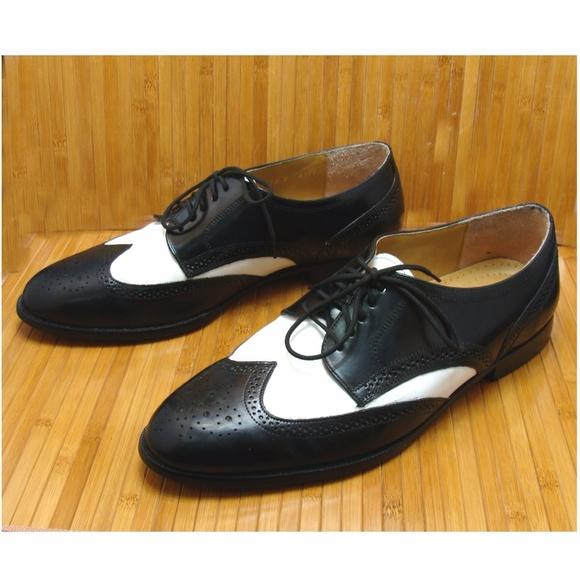 4154ab7a61a679 Vintage black white saddle oxford wingtip shoes. M 59cf124d4127d046f603ae52