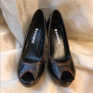 Black and tortoise shell peep toe heels