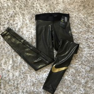 4d155414dd60f Nike Pants | Womens Size Xs Training Black Gold Metallic | Poshmark