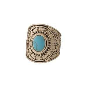 Gold tone bohemian ring with a turquoise stone