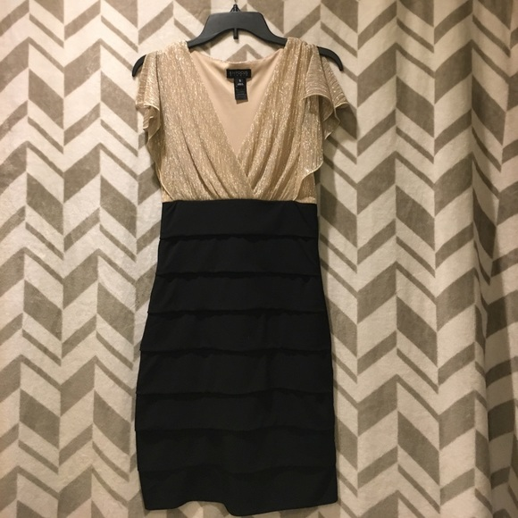 Dresses & Skirts - Gold and black party dress