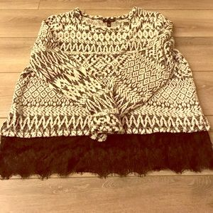 Fitted sweater with lace detailing.