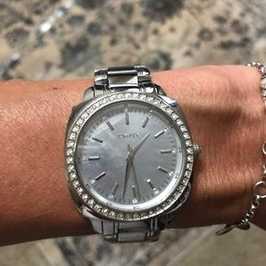 DKNY silver watch with crystals around the face.