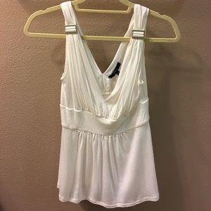 White sleeveless blouse with rhinestone clasps