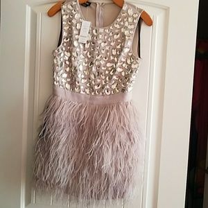 Dress NEVER WORN, COMES WITH TAGS ATTACHED