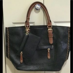 Large black soft faux leather fashion tote.