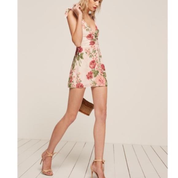 56db238cff8 CARMENSITA WHITE FLORAL MINI DRESS. M 59d2f1edbf6df5662401f53e. Other  Dresses you may like. Reformation ...