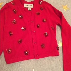 Vibrant red sweater with sequence embellishments