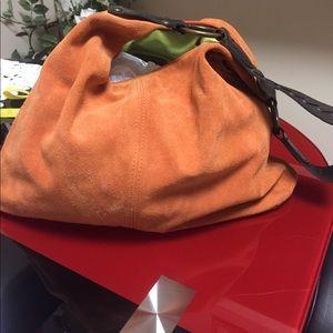 Orange suede hobo bag by Maurizio Taiuti
