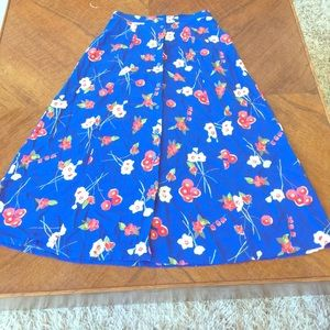 Blue skirt with flowers.
