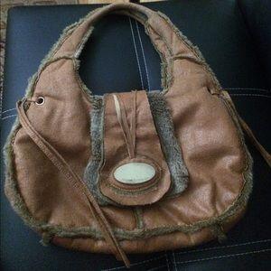 Saddle colored, sharp handbag