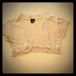 Cream colored shrug size medium