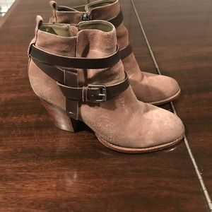 Ivanka trump suede ankle booties with a heel.