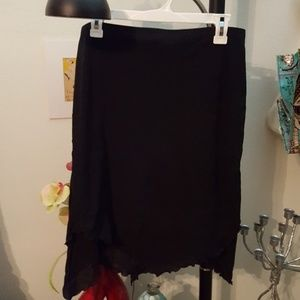 Black midi skirt w/asymmetrical bottom
