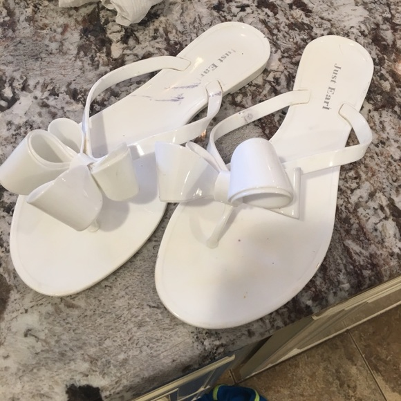 4cf9ee61840c7f Just Earl Shoes - White bow plastic flip flops