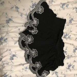 Billabong black shorts with white ruffle