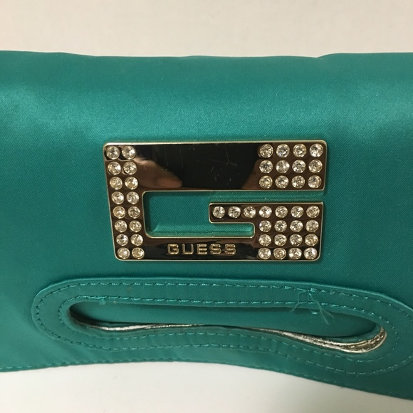 4d8610cfac61 G by Guess Handbags - Guess Satin Bag Converts   Fold to Magnetic Clutch