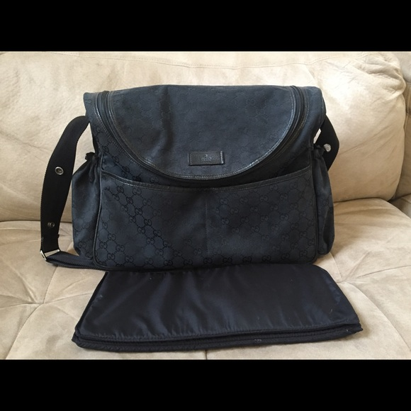 3853d47ba2eb25 Gucci Handbags - Black Gucci Diaper bag with changing pad.