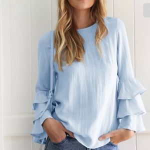 Tops - On trend ruffled sleeves blouse.
