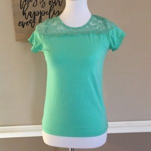 Minty green short sleeve shirt. Lace detail Size S