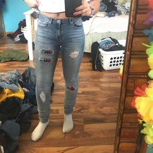 Holey plaid jeans