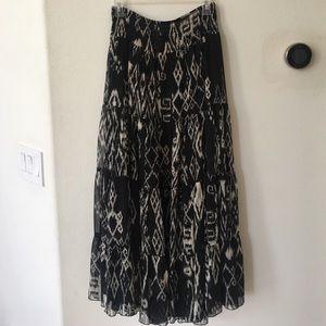 Long 37 inch fully lined, black/white print skirt.