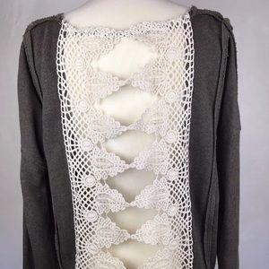 Free people boho open back lace crochet style top.