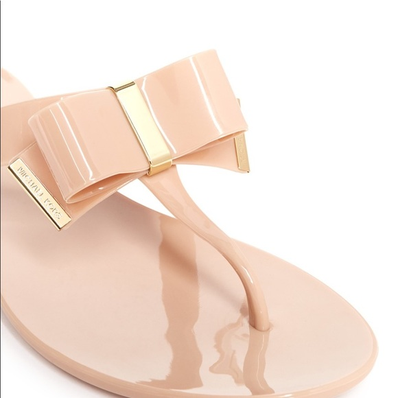 a9ad0695eae9 Kayden Jelly Nude Bow Sandal. M 59d6a75ef739bc4737037742. Other Shoes you  may like. Michael Kors MK Logo Womens ...