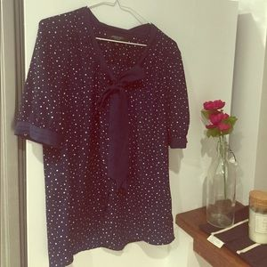 Snap front navy blue polka dot neck tie blouse