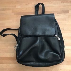 Vintage black backpack with many compartments!