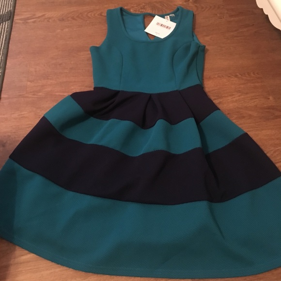 9bd9d026b42 Adorable teal and navy dress. NWT. sweet tea   caviar boutique