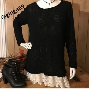Sweater black sheer with lace at the bottom.
