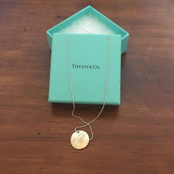 ed5b86e8d462 Tiffany Notes Alphabet Disc Charm necklace. M 59d8124e13302a811002596f
