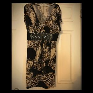 Stylish low cut dress with silver accents size Lg
