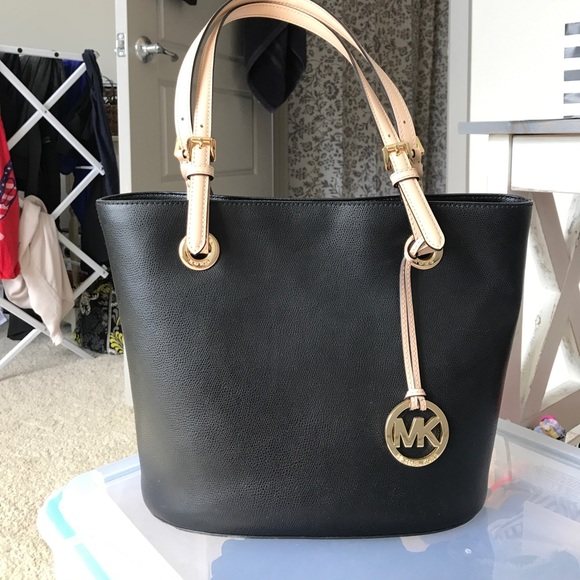 90db2903fed7 Black Michael Kors purse w/ light pink/tan straps.  M_59d9156bfbf6f90bbb05551b