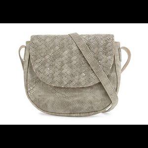 Neiman Marcus faux leather saddle bag. NWT