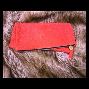 Clare vivier fold over clutch coral pebbled