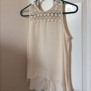 cream colored silk and lace sleeveless top