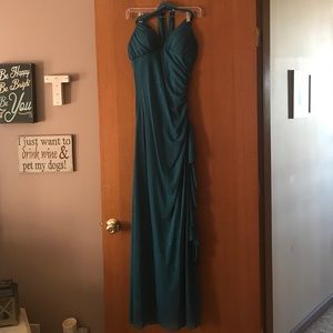 Beautiful sparkly teal prom dress.