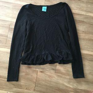 Versatile Black long sleeve top with ruffle hem