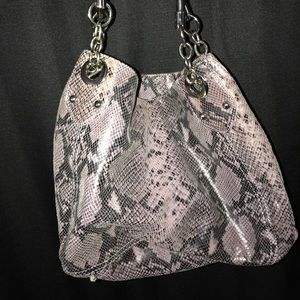 Purple leather snake skin purse.