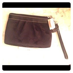 Cute, never used, Coach wristlet!