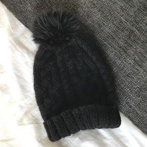 Eugenia Kim Black Pom Pom beanie hat.