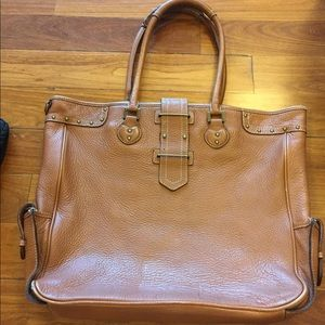 Leather tote with brass detailing