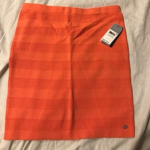 Coral peach colored fitted mini skirt by Guess