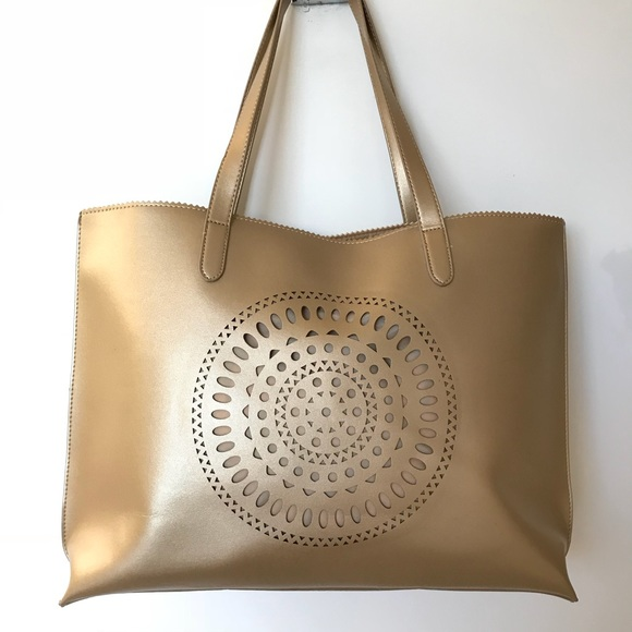Gold Laser-Cut Mandala Tote -NWOT. M 59dc1ae32fd0b72eea007b2a. Other Bags  you may like. Neiman Marcus ... a3e419895b